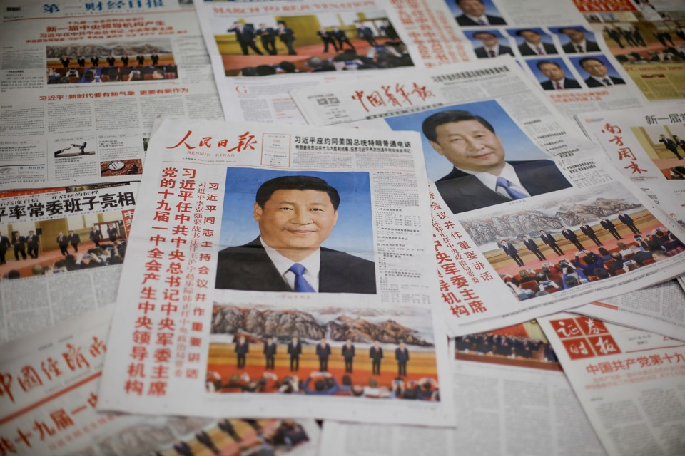 Newspapers with photos of Xi Jinping
