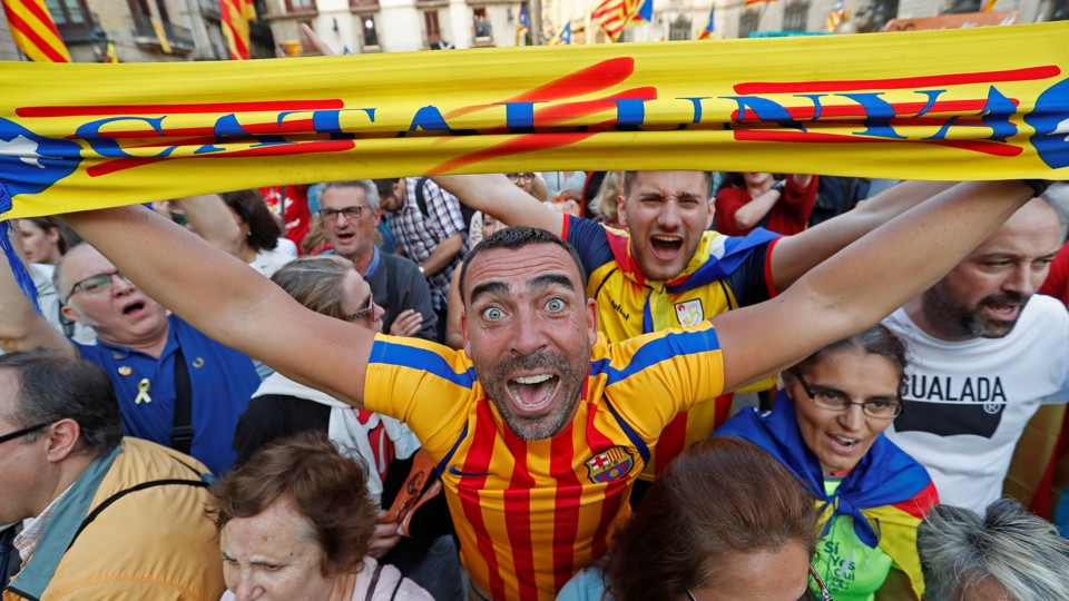 People in Barcelona react positively to the Catalan parliament's declaration of independence from Spain.