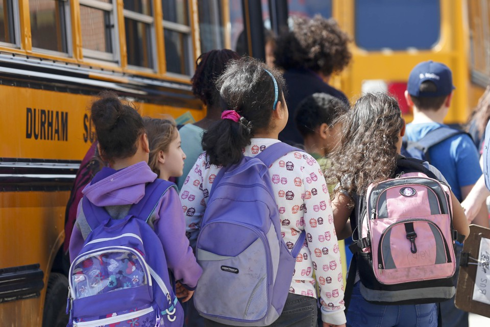 Students board a bus.