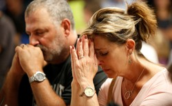 People pray during a vigil for the victims of a mass shooting in Las Vegas.