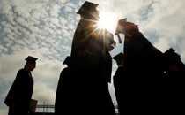 The silhouettes of several college graduates