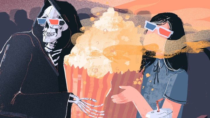 A moviegoer shares popcorn with a grim reaper.
