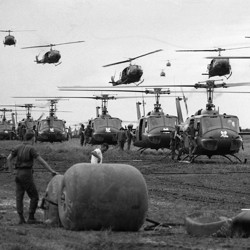 U.S. Huey helicopters fly in formation over a landing zone in South Vietnam during the Vietnam War, date unknown.