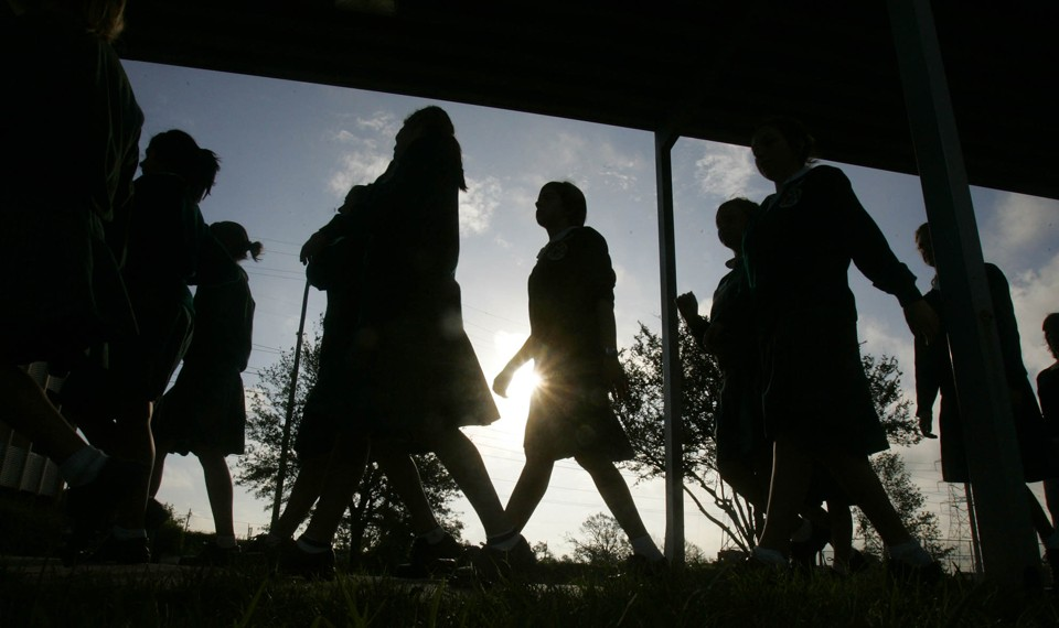 Students walk on campus in the morning.