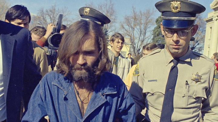 Charles Manson in handcuffs in 1970