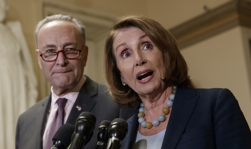 Senate Minority Leader Chuck Schumer and House Minority Leader Nancy Pelosi with microphones