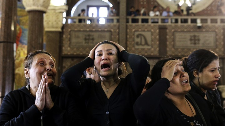 Women cry during the funeral for those killed in an ISIS attack in Alexandria Egypt, in April 2017.