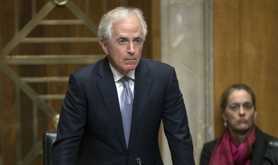 Senator Bob Corker of Tennessee stands in a hearing room.