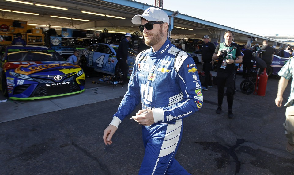 Dale Earnhardt Jr. walks through the garage area before practice for the NASCAR Cup Series auto race at Phoenix International Raceway