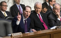 Democratic Senator Ron Wyden of Oregon argues with Republican Orrin Hatch of Utah during a committee debate over taxes.