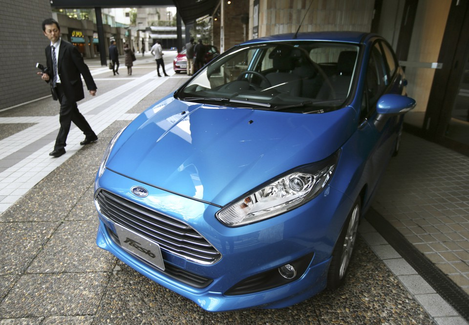 A Man Looks At Ford Compact Car In Japan Koi Sasahara AP