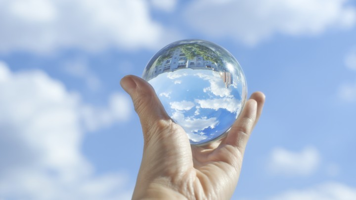 A crystal ball under a pleasant blue sky