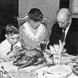 A family says grace before Thanksgiving dinner in the 1930s.