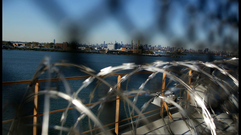 A view of Manhattan through barbed wire at a Rikers Island facility