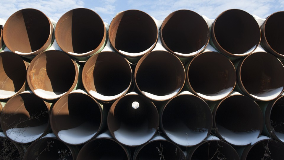 A stack of pipes that have collected snow