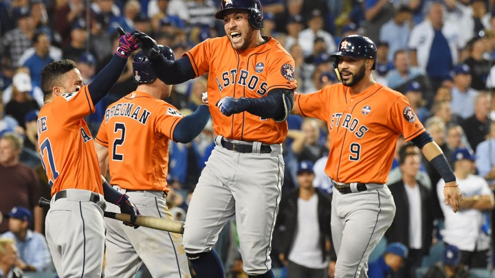 Houston Astros players celebrate after a two-run home run against the Los Angeles Dodgers in the second inning in game seven of the 2017 World Series at Dodger Stadium.