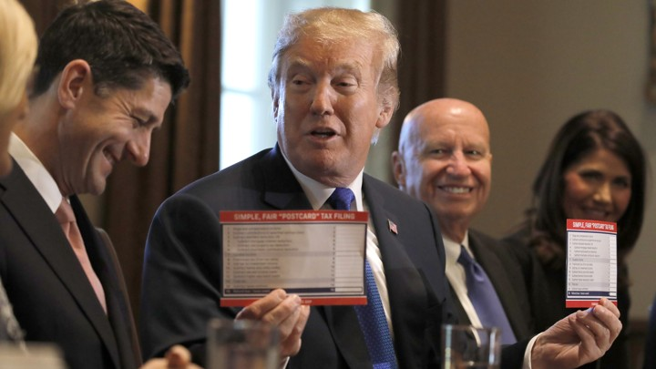 President Trump holds sample tax forms