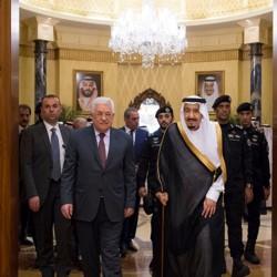 Saudi Arabia's King Salman bin Abdulaziz Al Saud walks with Palestinian President Mahmoud Abbas.