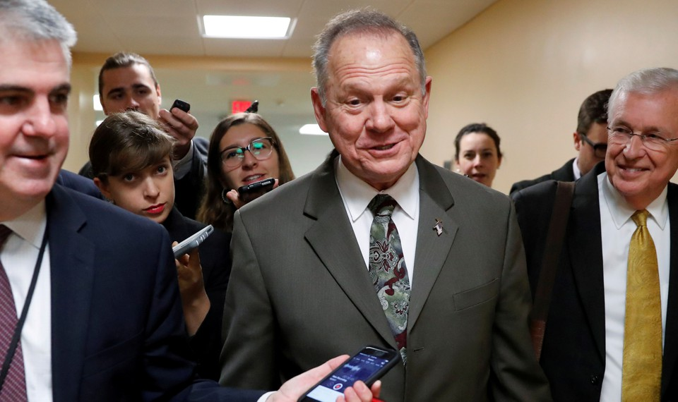 Alabama Republican Senate candidate Roy Moore speaks with reporters.