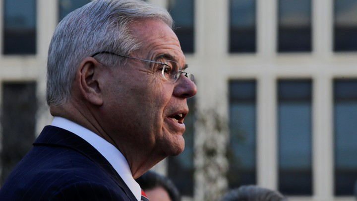 New Jersey Senator Bob Menendez addresses reporters outside a Newark courthouse.