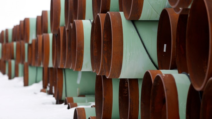 Large pipes stacked in snow