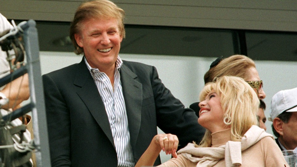 Donald Trump talks with Ivana Trump, his former wife, at the U.S. Open in