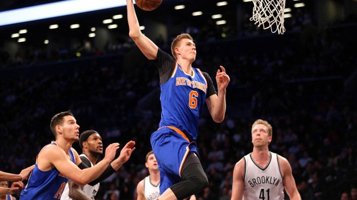 New York Knicks power forward Kristaps Porzingis dunks against the Brooklyn Nets