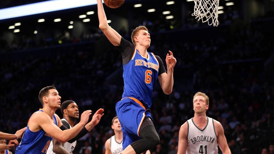 New York Knicks power forward Kristaps Porzingis dunks against the Brooklyn Nets