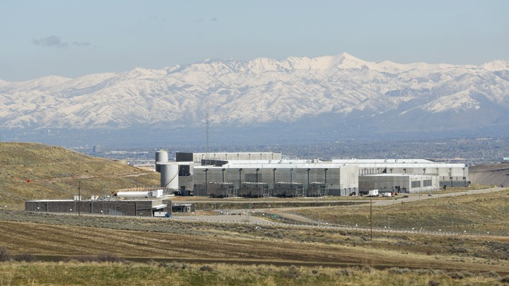 The NSA data center in Bluffdale, Utah, seen from a distance, with mountains in the background