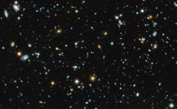 An image of galaxies and star clusters in space