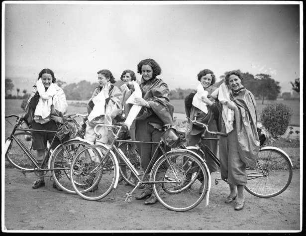 Women cyclists dry themselves off after getting wet during the 1936 N.C.U  cyclists rally at Alexandra Palace in London. Corbis Historical / Getty