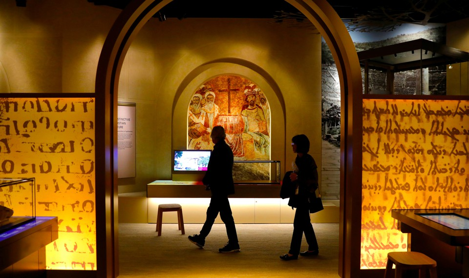 People walk through an exhibit at the Museum of the Bible in Washington, D.C.