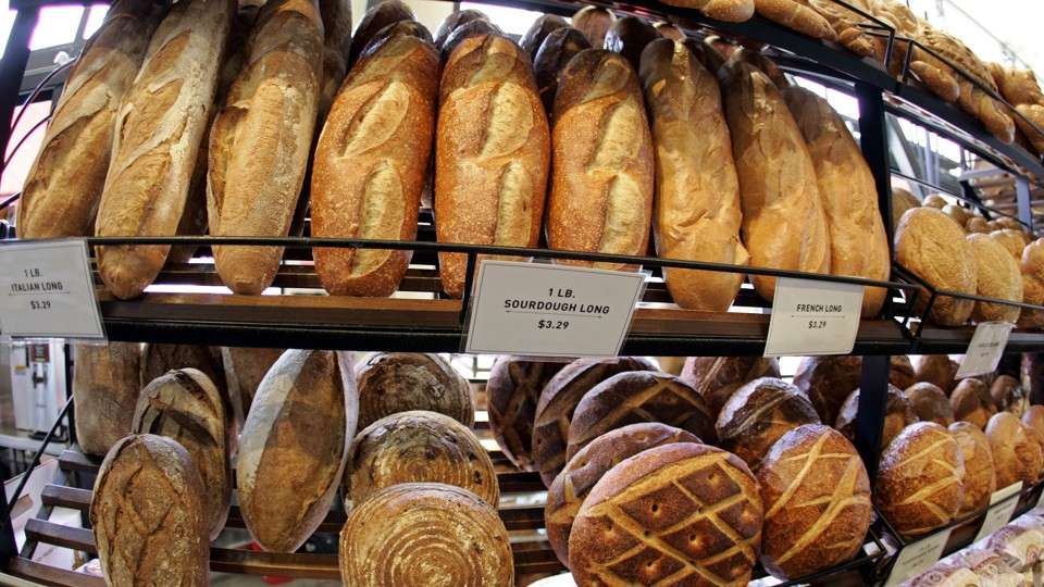Loaves of sourdough bread on shelves