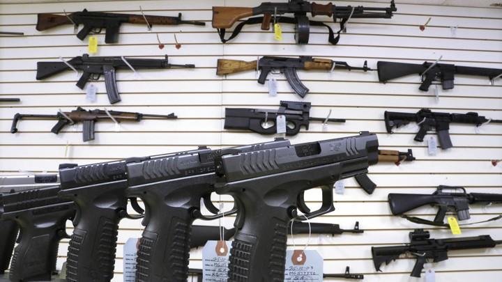 Handguns, rifles, and other guns on display