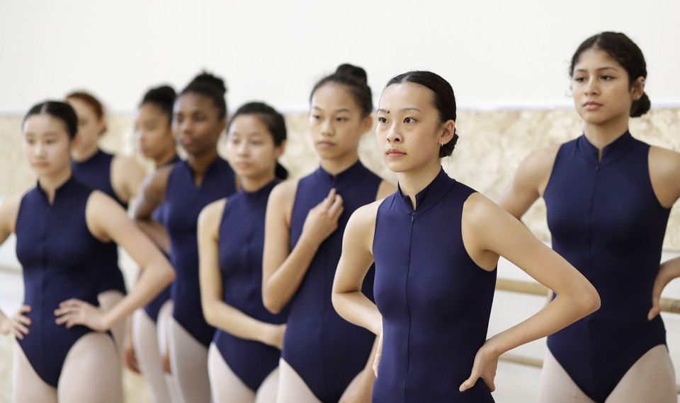Students at Ballet Tech, a public school in New York, listen to instruction during a dance class