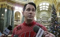 Wisconsin Governor Scott Walker speaks to reporters.