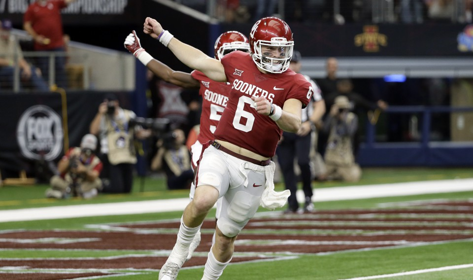 Oklahoma quarterback Baker Mayfield celebrates throwing a long pass for a touchdown
