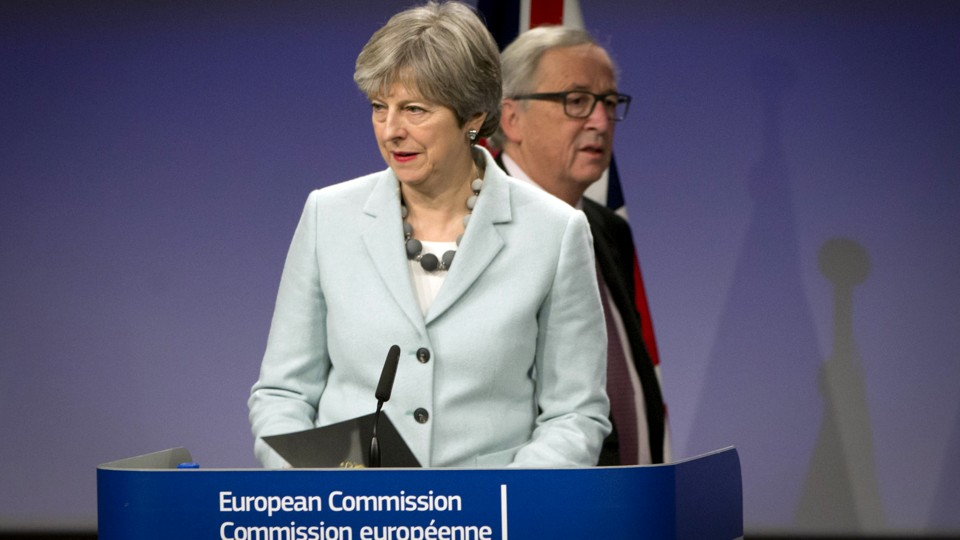 U.K. Prime Minister Theresa May and European Commission President Jean-Claude Juncker address the media at the EU headquarters in Brussels on December 8, 2017.