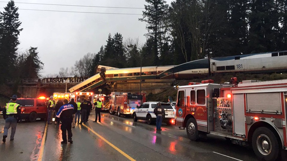 Firefighters and police on the scene of a trail derailment