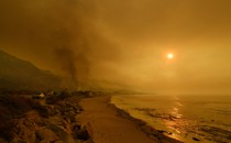 Heavy smoke covers the seaside enclave of Mondos Beach north of Los Angeles, California from wildfires in the region