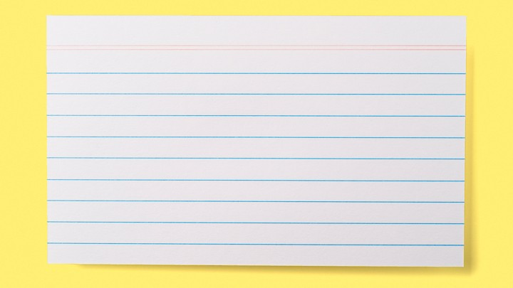 A lined index card on a yellow background