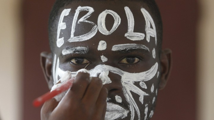 "An actor with ""EBOLA"" written across his forehead"
