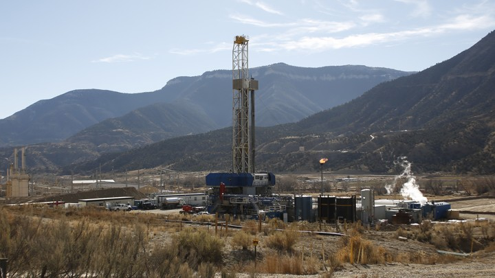 A fracking well near mountains