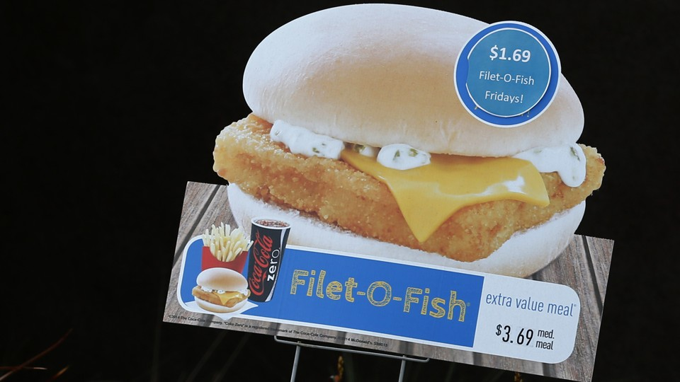 A sign advertising a McDonald's Filet-O-Fish sandwich Mike Blake / Reuters