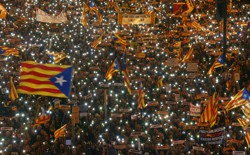 Protesters wave Estelada flags during a demonstration.