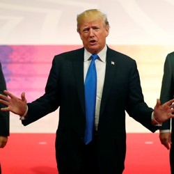 Donald Trump gestures with National Security Advisor H.R. McMaster and Secretary of State Rex Tillerson