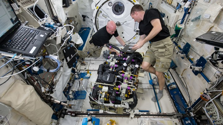 Astronauts work in the International Space Station.