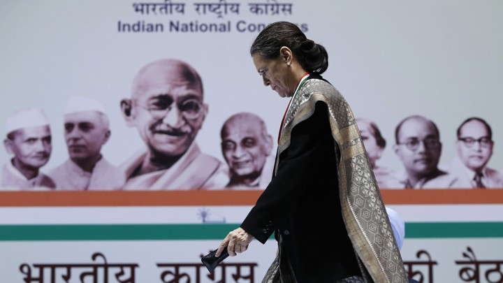 Sonia Gandhi walks to address her party workers at the All India Congress Committee meeting in New Delhi on January 17, 2014.