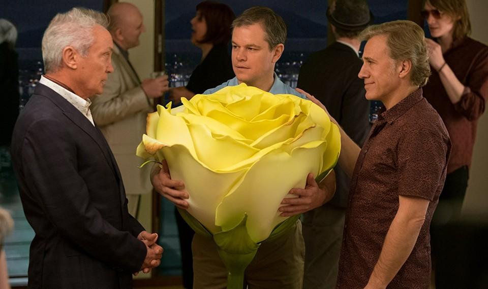 Udo Kier, Matt Damon with a big flower, and Christoph Waltz in 'Downsizing'