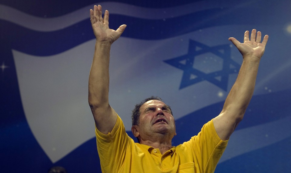 A Christian worshipper prays during an evangelical rally in Jerusalem.